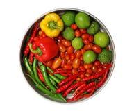 Pepper, lemon, tomato, lime. On white background Royalty Free Stock Image