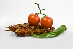 Pepper and meat. Shish kebab of their fresh meat, a tomato and pepper royalty free stock photos