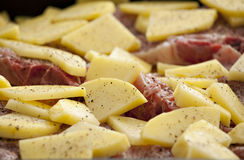 Pepper meat and potatoes. Prepared for baking Royalty Free Stock Photography