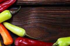 Pepper. Mexican hot chili peppers colorful mix habanero poblano. Serrano jalapeno on wood royalty free stock photo