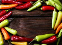 Pepper. Mexican hot chili peppers colorful mix habanero poblano. Serrano jalapeno on wood royalty free stock photos