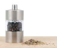 Pepper mill. On cutting board with salt Royalty Free Stock Photos