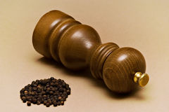 Pepper-mill and Grains. Pepper-mill and black pepper grains stock photography