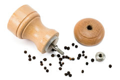 Pepper mill lying in pepper corn Royalty Free Stock Photo