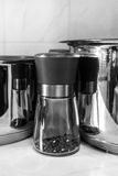 Pepper mill. Pans and pepper mill in the kitchen Royalty Free Stock Photography