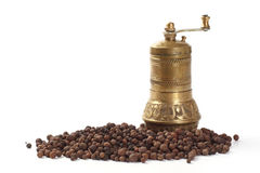 Pepper mill and peppercorn Stock Photo