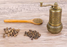 Pepper and mill and spoon Royalty Free Stock Image