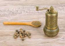 Pepper and mill and spoon Stock Image