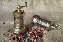 Pepper mills and peppercorns Stock Photo