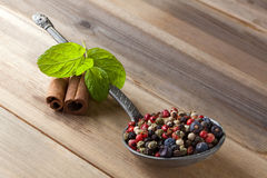 Pepper mixture. Unground mixture of pepper in an antique pewter spoon Stock Photography