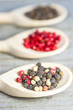 Pepper mixture. Of black and mixed and pink seeds Royalty Free Stock Image