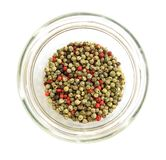 Pepper multicolor in glass dish. Black pepper (Piper nigrum) is a flowering vine in the family Piperaceae, cultivated for its fruit, which is usually dried and Royalty Free Stock Photo