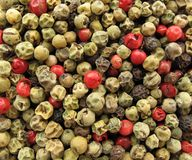 Pepper multicolor whole seeds. Black pepper (Piper nigrum) is a flowering vine in the family Piperaceae, cultivated for its fruit, which is usually dried and Stock Photos