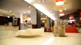Pepper and napkins on a table in  cafe stock footage