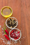 Pepper and oil. On brown background Stock Photography