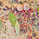 Pepper and other spices and grains. On raw wooden table stock image