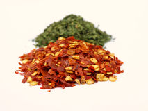 Pepper and parsley Stock Images