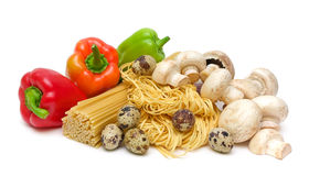 Pepper, pasta, mushrooms, eggs on a white Stock Photos