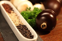 Pepper and a pepper mill Stock Photos