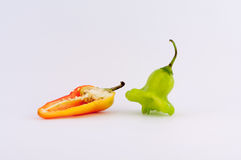 Pepper. S in different colors and shapes on a white background stock photos