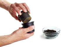 Pepper pestle. Pounded black pepper and a glass bowl with pepper corns Royalty Free Stock Photo