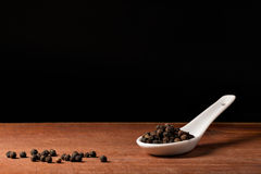 Pepper (piper nigrum) on a spoons Royalty Free Stock Photography