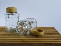 Pepper pot and salt shaker stand empty on a cutting board on a white background. royalty free stock images