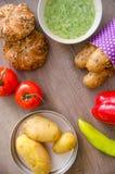 Pepper, potato, kaiser bun and baguette on wood table. Vegetarian bio food concept. Stock Photo