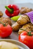 Pepper, potato, kaiser bun and baguette on wood table. Vegetarian bio food concept. Stock Photography