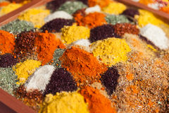 Pepper powder herbal spice condiment ingredients at food market. Multi color pepper powder and other herbal spice condiment ingredients at food market Stock Photos