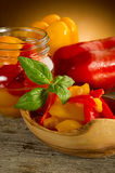 Pepper preserved on bowl. Pepper preserved on wood  bowl Royalty Free Stock Image