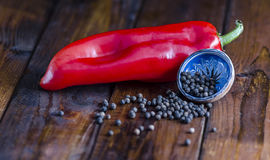 Pepper and red Pepper. On a wooden background Stock Photo