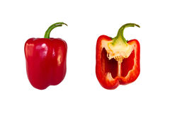 Pepper. Red peppers, whole and half, on a white background Royalty Free Stock Images
