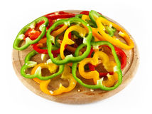 Pepper rings on wood Stock Photo