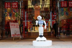 A Pepper robot on duty outside a Tokyo clothing store Stock Photos
