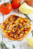 Pepper, rosemary and sausage pizza Royalty Free Stock Images