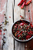 Pepper. On rustic wooden background/ mixture of s hot , red , black , white , green , background. Selective focus Stock Photography