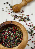 Pepper's mix. In the wooden mortar with pestle Royalty Free Stock Photography