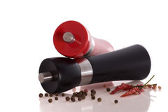 Pepper and salt mill. Large polished wooden, pepper/salt mill with chilli on white background stock photography