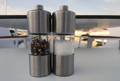 Pepper and salt mills on a restaurant table royalty free stock photos