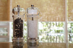 Pepper and salt shakers on the table Stock Photo