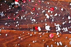 Pepper and salt on wood background. Red pepper and sea salt placed on wood hardboard Stock Photography