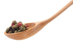 Pepper seasoning  mix in wooden spoon isolated on white backgrou Stock Photography