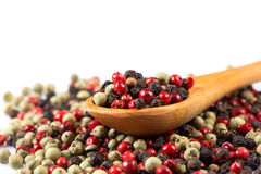 Pepper seasoning mix in wooden spoon Stock Photos