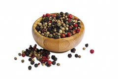 Pepper seeds in wooden bowl isolated Royalty Free Stock Photography