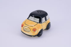 Pepper shaker and saltcellar in car shape ceramic isolated on wh Stock Photo