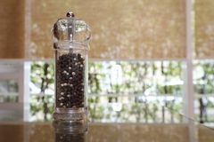 Pepper shaker on the table Royalty Free Stock Photos