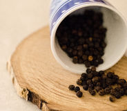 Pepper. Some peppercorns that come out of a cup royalty free stock image