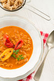 Pepper soup also full grain noodles Royalty Free Stock Photos