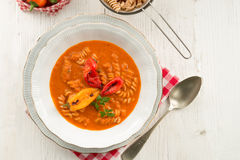 Pepper soup also full grain noodles Stock Photos